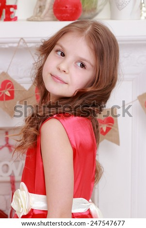 Cute little girl in red dress  - stock photo