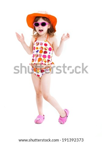 Cute little girl in swimsuit ,sunglasses and sun hat posing isolated on white background - stock photo