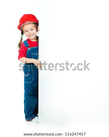 cute little girl in the construction helmet with a white board - stock photo