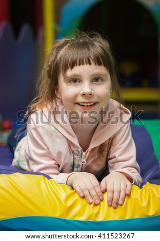 Cute little girl in the playroom - stock photo