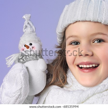 cute little girl in warm clothes - stock photo