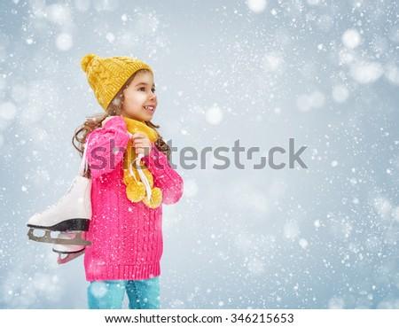 cute little girl is going skate - stock photo