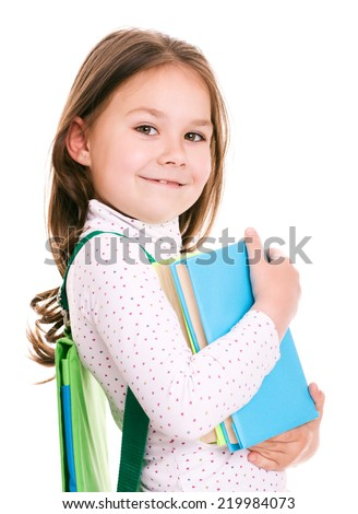 Cute little girl is playing with book, isolated over white - stock photo