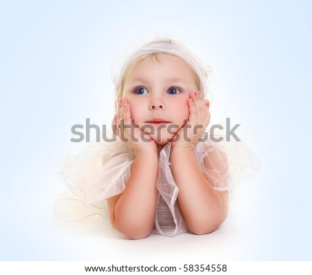 cute little girl isolated on blue - stock photo