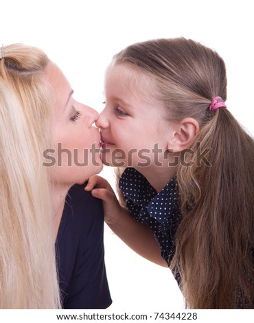 Cute little girl kissing her mother, isolated on white background - stock photo