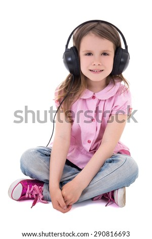 cute little girl listening music in headphones isolated on white background - stock photo