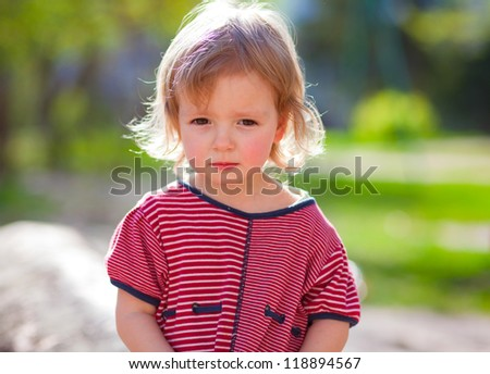 Cute little girl looking sadly - stock photo