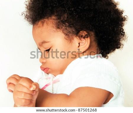 Cute little girl lying on white - stock photo