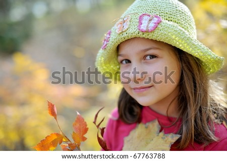 cute little girl outdoor in autumn - stock photo