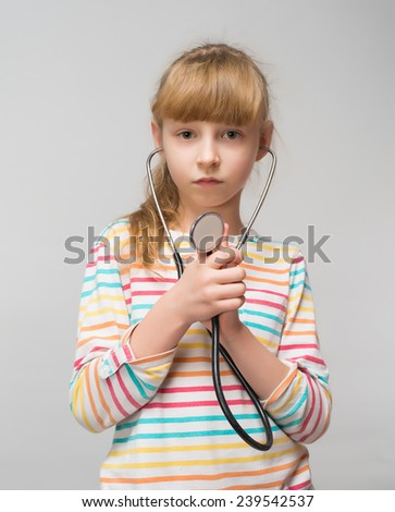 cute little girl playing doctor - stock photo