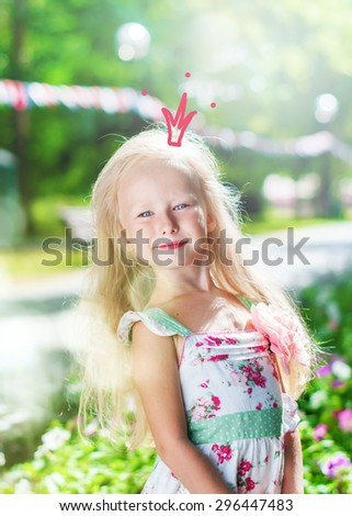 Cute Little Girl Posing as Princess with Drawn Crown in Morning Park - stock photo