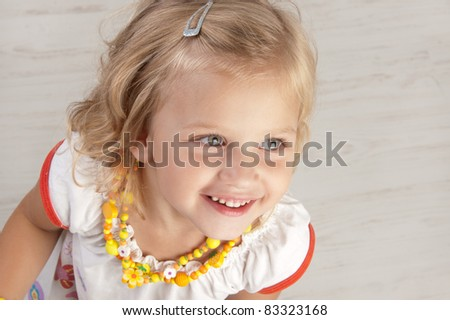 Cute little girl posing  for the camera and looking up  close-up - stock photo