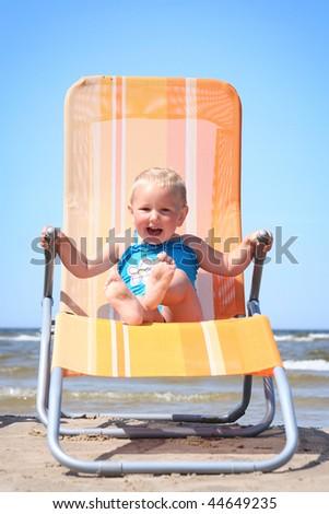cute little girl relaxing on beach - stock photo