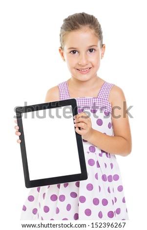 Cute little girl showing blank tablet screen - stock photo