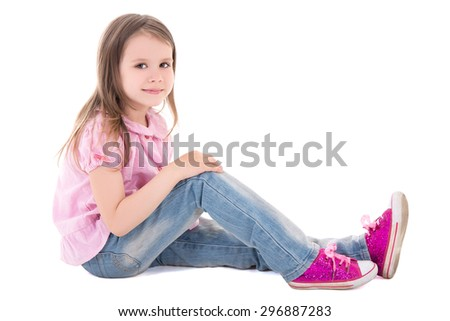 cute little girl sitting isolated on white background - stock photo