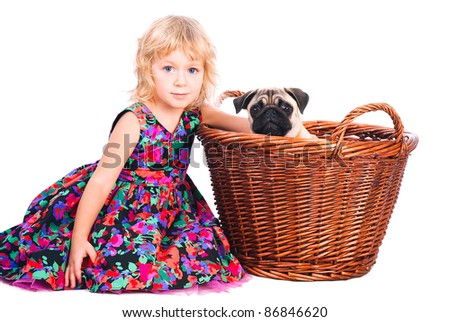 cute little girl sitting with dog in backet  isolated on white background - stock photo
