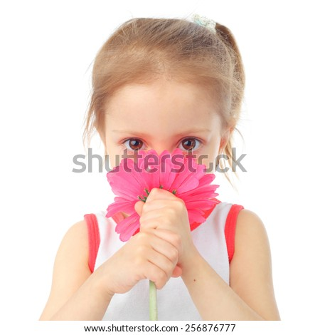 cute little girl smelling the big flower - stock photo