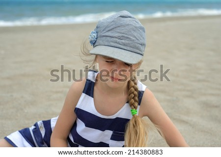 Cute little girl squinted - stock photo