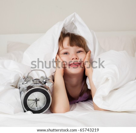 cute little girl unwilling to wake up in the morning - stock photo