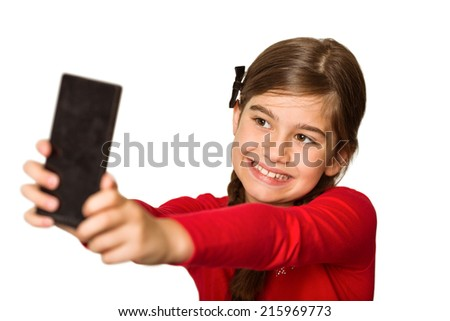 Cute little girl using smartphone on white background - stock photo