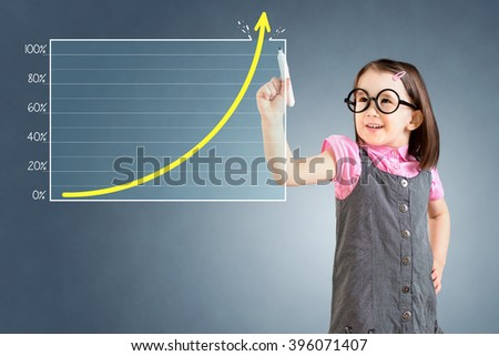 Cute little girl wearing business dress and drawing over target achievement graph. Blue background. - stock photo