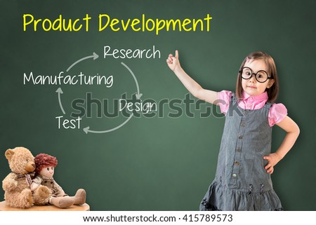 Cute little girl wearing business dress and showing product development concept on green chalk board. - stock photo