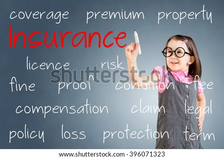 Cute little girl wearing business dress and writing insurance concept. Blue background. - stock photo