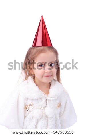 cute little girl wearing the birthday cap - stock photo