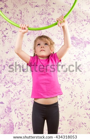 cute little girl with a huls hoop - stock photo