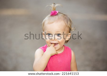 Cute little girl with a pink hair tie - stock photo