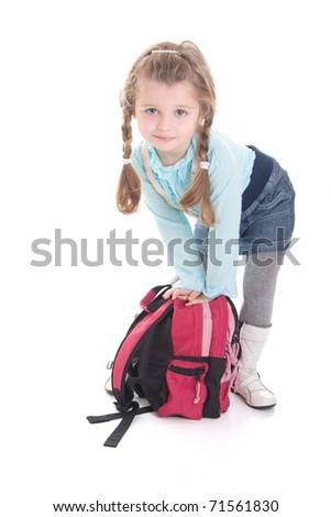 Cute little girl with backpack isolated on white background - stock photo