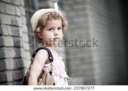 Cute little girl with bag - stock photo
