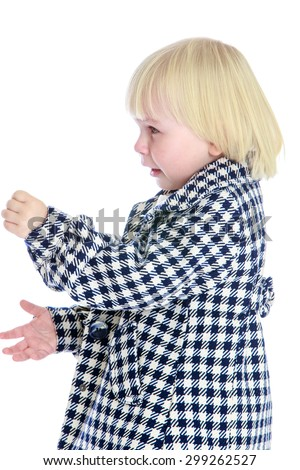 Cute little girl with blond short-cropped hair wearing a plaid coat turned sideways to the camera , close-up-Isolated on white background - stock photo