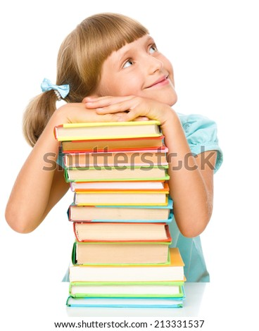 Cute little girl with books, isolated over white - stock photo