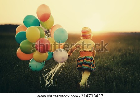 cute little girl with colorful balloons - stock photo