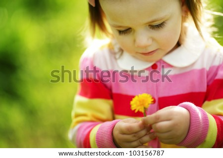 cute little girl with dandelion - stock photo