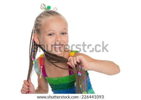 Cute little girl with dreadlocks in the hands on a white background. Girl is six years old. - stock photo
