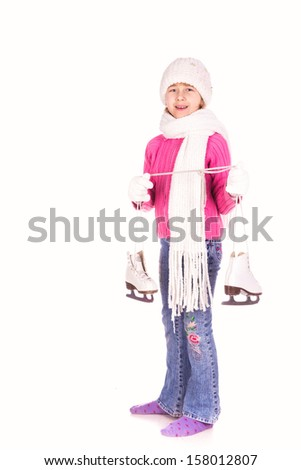 Cute little girl with figure skates isolated on white - stock photo