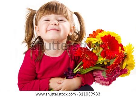 Cute little girl with gerbera flowers bouquet - stock photo