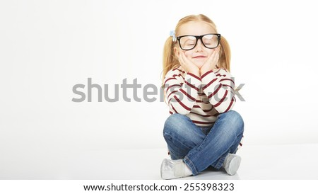 Cute little girl with glasses on a white background - stock photo
