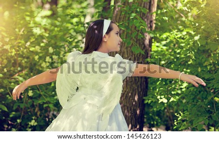Cute Little Girl with her First Communion Dress - stock photo
