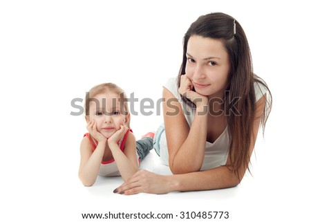 cute little girl with her pretty young mother - stock photo