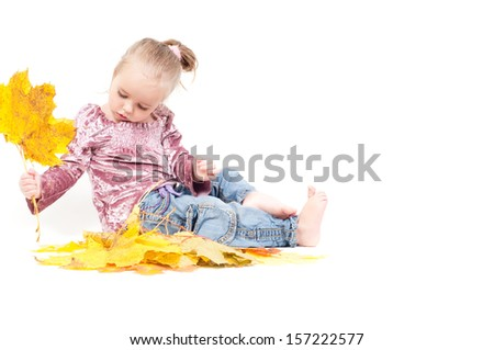 Cute little girl with maple leaves - stock photo