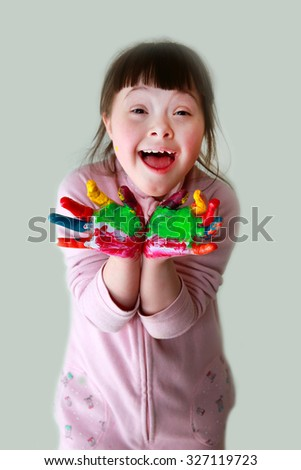 Cute little girl with painted hands . - stock photo
