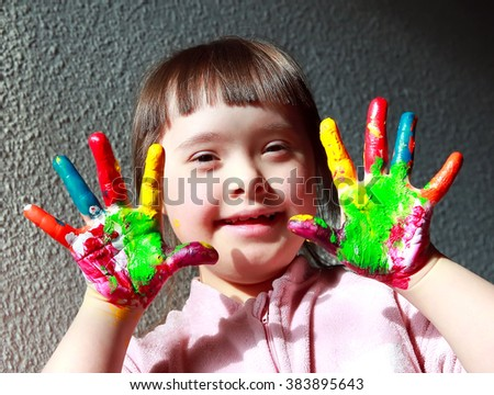 Cute little girl with painted hands. - stock photo