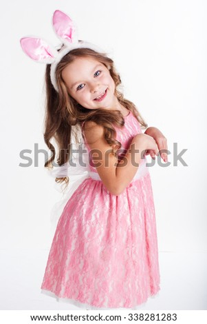 Cute little girl with pink bunny ears isolated on white background - stock photo