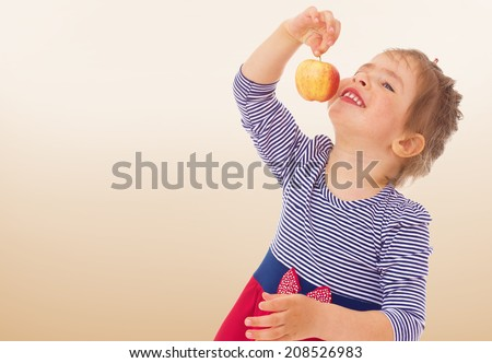 cute little girl with red apple.kindergarten, the concept of childhood and joy, teens - stock photo