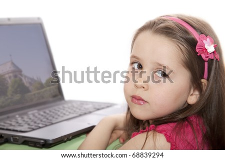 Cute little girl with the laptop - stock photo