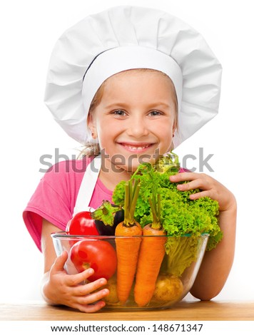 cute little girl with vegetables on a white background - stock photo