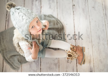 Cute little girl with winter hat - stock photo